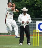 Anees Davids comes in to bowl