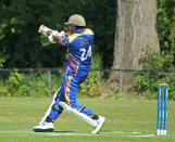 Ahsan Masood belts one over midwicket