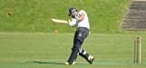 Bukhari smashes the ball past the bowler