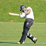 Bukhari smashes the ball past the bowler