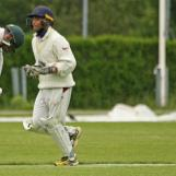 Asad is bowled by Asief Hoseinbaks while charging