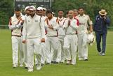 The Dosti team are led off the field by Match-winner Kohli