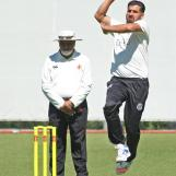 Dost Muhammad coming in to bowl