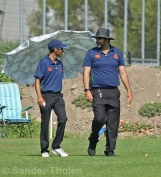Umpires Nitti and Akram after the break