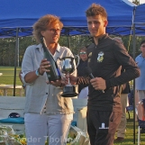 HBS Captain Tobias Visée is presented with the Cup by KNCB Chair Betty Timmer