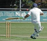 Ahmed plays a backhand