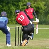 Cooper scores over midwicket