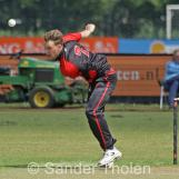 Dirk van Baren bowling from the Pavilion End