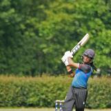 Vikram Singh hits a four