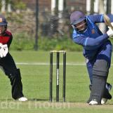 Wesley Barresi lofts a straight drive and is caught by bowler Saqib Zulfiqar