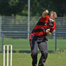 Pierce Fletcher bowling from the Station End