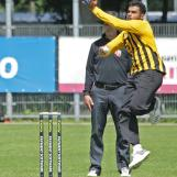Raafieq Isaacs coming in to bowl