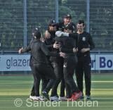...and the boys in black celebrate!