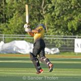 Umar Baker hits the winning six into the sightscreen