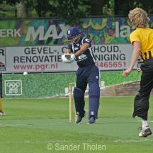 Jay Bista swings at a wide one from Overdijk