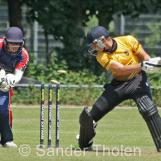 Tom Heggelman chops the ball into his stumps
