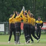 Celebrations of the wicket of Zak Gibson
