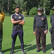 Umpires Butt and Das and Captains Tariq and Tewarie