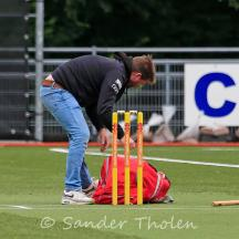 The HBS team manager prepares the wicket