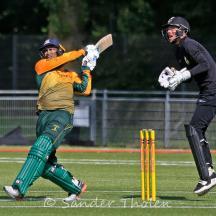 Teja Nidamanuru wacks the ball to mid-wicket