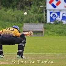 Umar Baker ducks under a rising ball