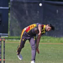 Waheed Masood bowling from the Airport End